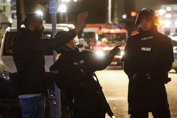 PHOTO: Police officers speak with a man as they secure the area after a shooting in Hanau, near Frankfurt, Germany, Feb. 19, 2020. (Kai Pfaffenbach/Reuters)