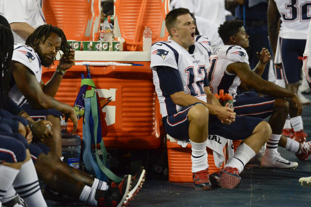 New England Patriots quarterback Tom Brady (12) yawns as he sits on the sideline in the second half of a preseason NFL football game against the Tennessee Titans Saturday, Aug. 17, 2019, in Nashville, Tenn. The Patriots won 22-17. (AP Photo/Mark Zaleski)