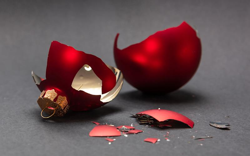 Christmas accident. Red Christmas ball broken, dark gray background, closeup view