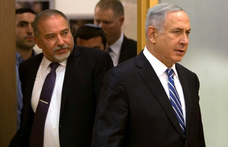 Former defence minister Avigdor Lieberman (L) has gained in popularity since April's election which saw Netanyahu (R) fail to put together a coalition (AFP Photo/MENAHEM KAHANA)