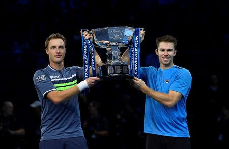 Tennis - ATP World Tour Finals - The O2 Arena, London, Britain - November 19, 2017   Finland's Henri Kontinen and Australia's John Peers celebrate winning the doubles final against Poland's Lukasz Kubot and Brazil's Marcelo Melo with the trophy   Action Images via Reuters/Tony O'Brien