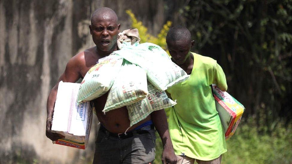 A man carrying bags of rice