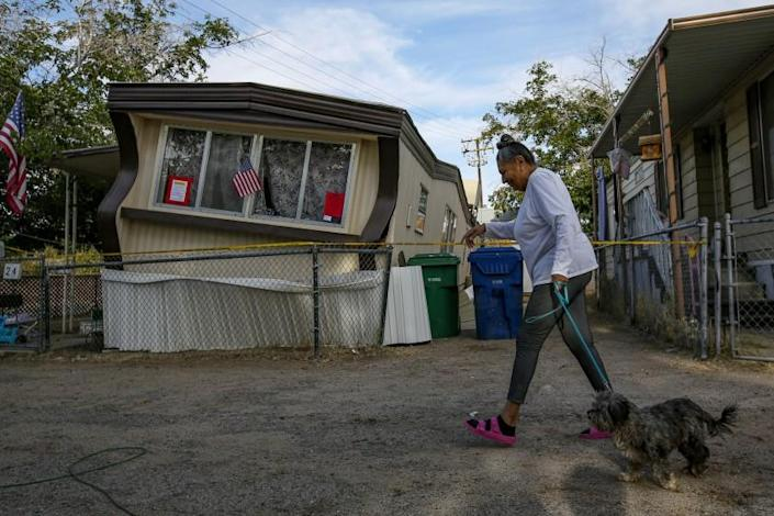 Irfan KhanLos Angeles Times CARMEN RIVERA walks in Ridgecrest, Calif., a day after the first earthquake. It is plausible that a car fell on a man from the shaking felt in Pahrump, Nev.