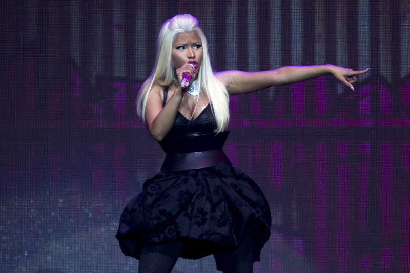 "FILE - This Nov. 24, 2012 file photo shows rapper and singer-songwriter Nicki Minaj performing on her Pink Friday: Reloaded Tour in Auckland, New Zealand. Despite having a big year in music, Nicki Minaj didn't receive any Grammy nominations. The 30-year-old had one of last year's biggest hits with the multiplatinum dance-pop anthem ""Starships."" Her sophomore album, ""Pink Friday: Roman Reloaded,"" has reached gold status and launched other hits on the rap and R&B charts. But Minaj was shunned out when the Grammys announced this year's nominees, though the animated performer earned three nominations last year, including best new artist and best rap album for her platinum debut, ""Pink Friday."" (AP Photo/SNPA, David Rowland, file)"