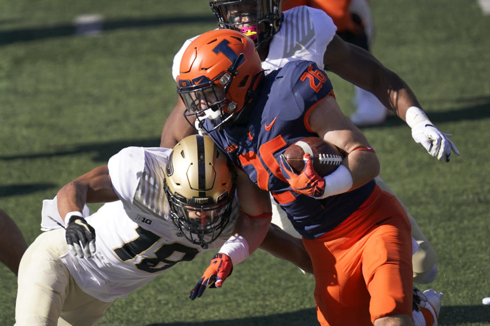 Illinois running back Mike Epstein (26) carries the ball as Purdue cornerback Cam Allen defends during the first half of an NCAA college football game Saturday, Oct. 31, 2020, in Champaign, Ill. (AP Photo/Charles Rex Arbogast)