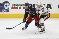 Columbus Blue Jackets' Cam Atkinson, left, controls the puck as Chicago Blackhawks' Carl Soderberg defends during the third period of an NHL hockey game Saturday, April 10, 2021, in Columbus, Ohio. (AP Photo/Jay LaPrete)