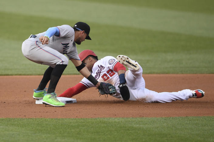 Washington Nationals' Juan Soto steals second against Miami Marlins shortstop Miguel Rojas, left, during the first inning of a baseball game Wednesday, July 21, 2021, in Washington. (AP Photo/Nick Wass)