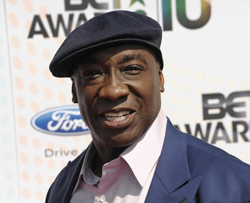 """FILE - This June 27, 2010 file photo shows actor Michael Clarke Duncan at the BET Awards in Los Angeles. Publicist Joy Fehily said in a brief email statement Monday, Aug. 6, 2012, that the 54-year-old actor """"was just moved from the intensive care unit, but remains hospitalized"""" following his July 13 heart attack. (AP Photo/Dan Steinberg, file)"""