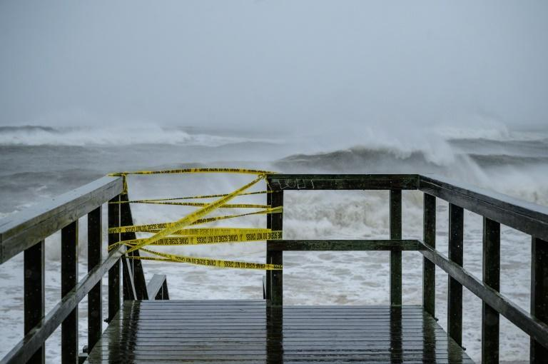 A beach access point is closed as waves from Tropical Storm Henri approaches, in Montauk, Long Island on August 22, 2021