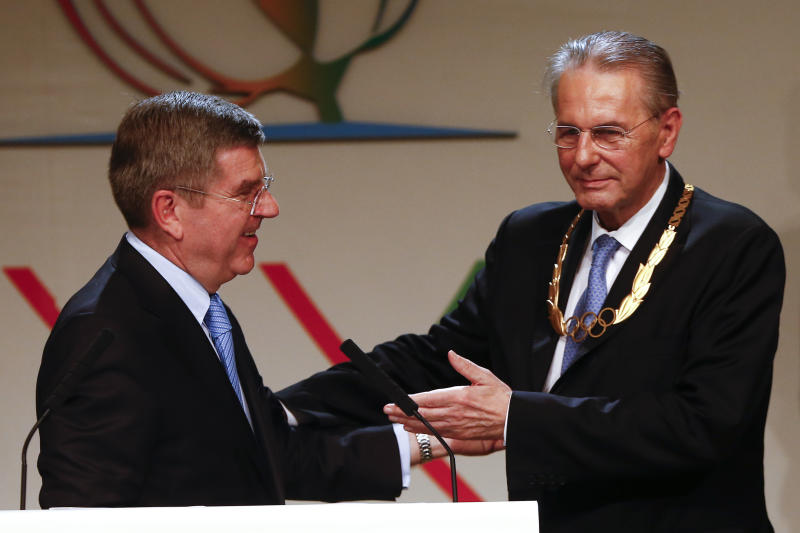 Jacques Rogge, right, outgoing president of the International Olympic Committee (IOC), points to Thomas Bach of Germany after Bach was elected the new IOC president during the 125th IOC session in Buenos Aires, Argentina, Tuesday, Sept. 10, 2013. (AP Photo/Victor R. Caivano)