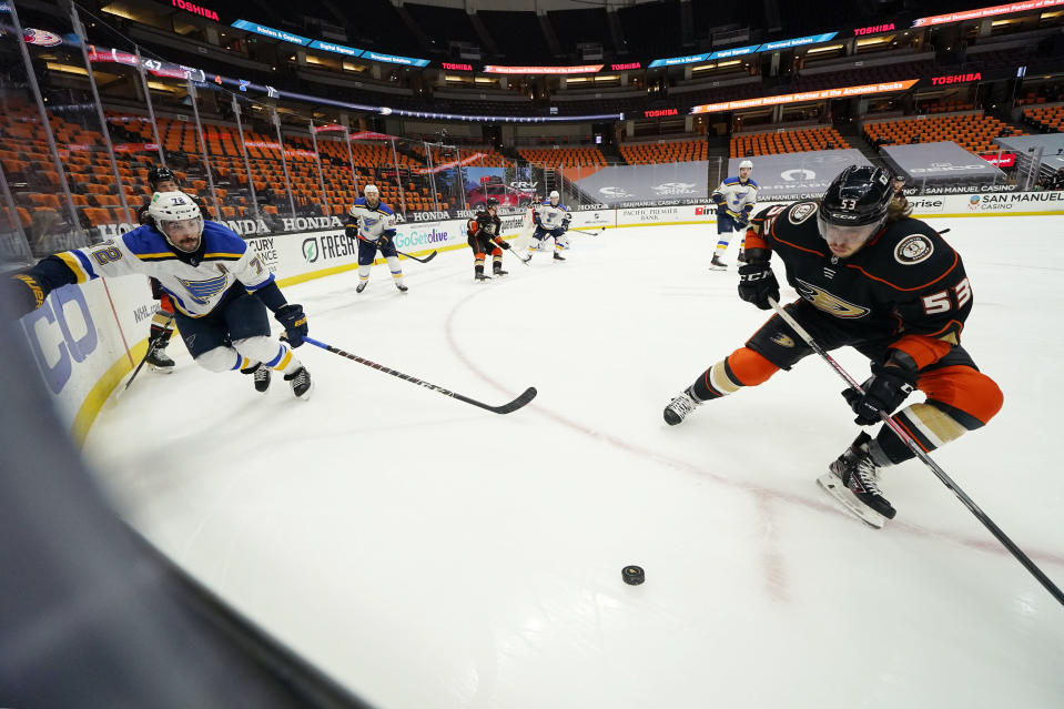 Anaheim Ducks left wing Max Comtois, right, takes the puck as St. Louis Blues defenseman Justin Faulk chases during the second period of an NHL hockey game Monday, March 1, 2021, in Anaheim, Calif. (AP Photo/Mark J. Terrill)