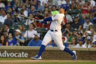 Chicago Cubs' Anthony Rizzo watches his two-run home run during the first inning of a baseball game against the Cincinnati Reds, Monday, July 26, 2021, in Chicago. (AP Photo/Paul Beaty)