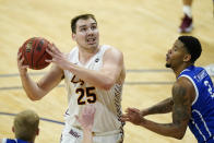 Loyola of Chicago center Cameron Krutwig (25) drives to the basket past Drake forward Tremell Murphy, right, during the first half of an NCAA college basketball game, Sunday, Feb. 14, 2021, in Des Moines, Iowa. (AP Photo/Charlie Neibergall)