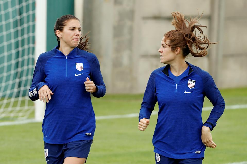 Alex Morgan (left) told Kelley O'Hara the Olympic postponement gave her time to breathe after giving birth to her daughter, Charlie. (REUTERS/Gonzalo Fuentes)