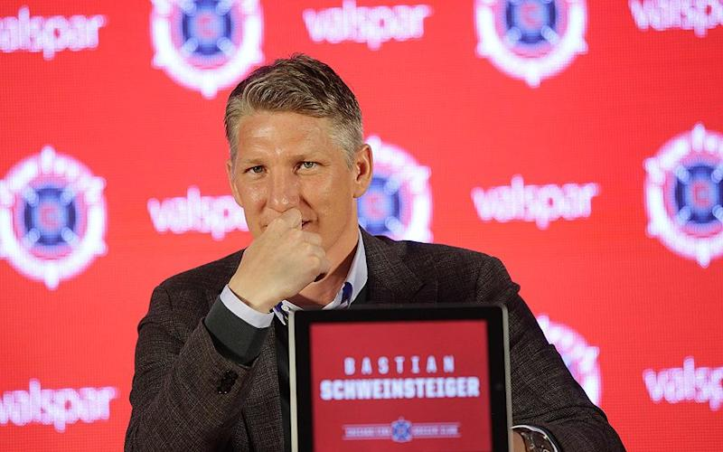 Calm before the storm: Bastian Schweinsteiger at his Chicago Fire unveiling - AFP