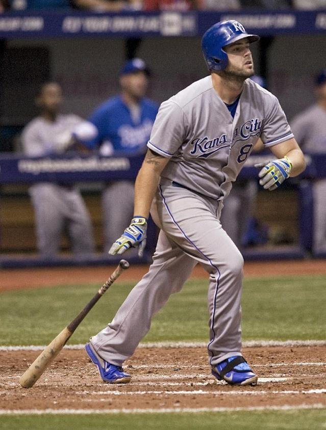 Kansas City Royals' Mike Moustakas hits a RBI sacrifice fly to right field off Tampa Bay Rays reliever Juan Oviedo during the eighth inning of a baseball game Monday, July 7, 2014, in St. Petersburg, Fla. (AP Photo/Steve Nesius)