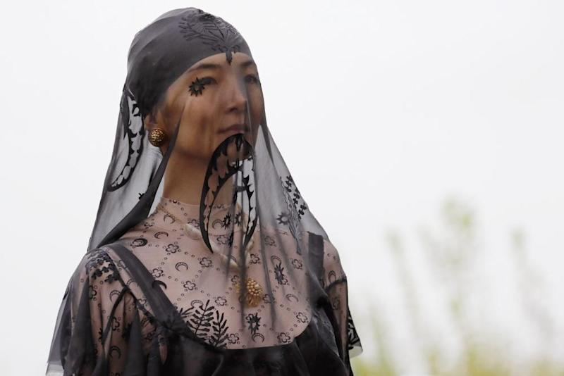 A model wearing a veil which prominently features the crescent moon logo at the spring/summer 20 show.