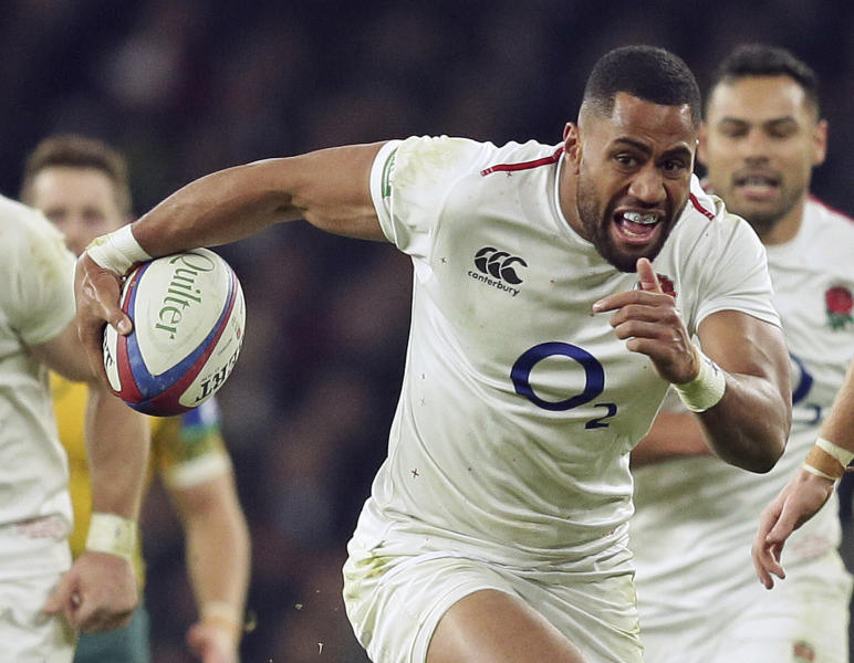 FILE - In this file photo dated Saturday, Nov. 24, 2018, England's Joe Cokanasiga runs with the ball during the rugby union international against Australia at Twickenham in London. England have made four changes for the Six Nations match against Scotland on Saturday March 16, 2019, with Cokanasiga missing the match, being replaced by Jack Nowell. (AP Photo/Tim Ireland, FILE)