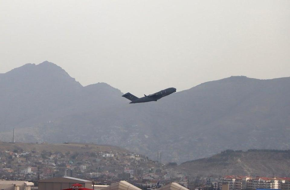 A US military aircraft takes off from the Hamid Karzai International Airport in Kabul on Monday  (AP)