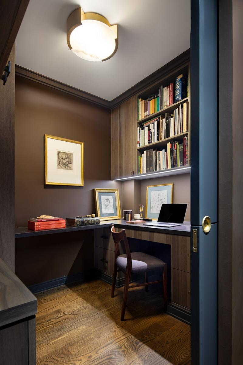 """A pocket door separates the library from Bailey's office, where an American walnut desk and cabinetry is illuminated by an alabaster-and-brass fixture by Kelly Wearstler. A Lucien Freud sketch hangs on the wall. """"Anywhere the couple wanted privacy we put a pocket door,"""" explains Rabel. """"When they're open, the apartment feels like a huge loft."""""""