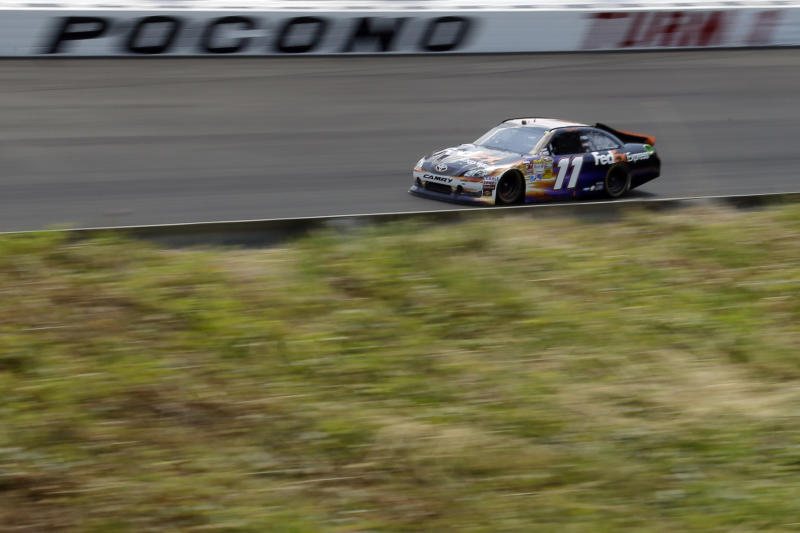 Denny Hamlin drives through Turn 1 during the NASCAR Sprint Cup Series auto race, Sunday, June 10, 2012, in Long Pond, Pa. (AP Photo/Matt Slocum)