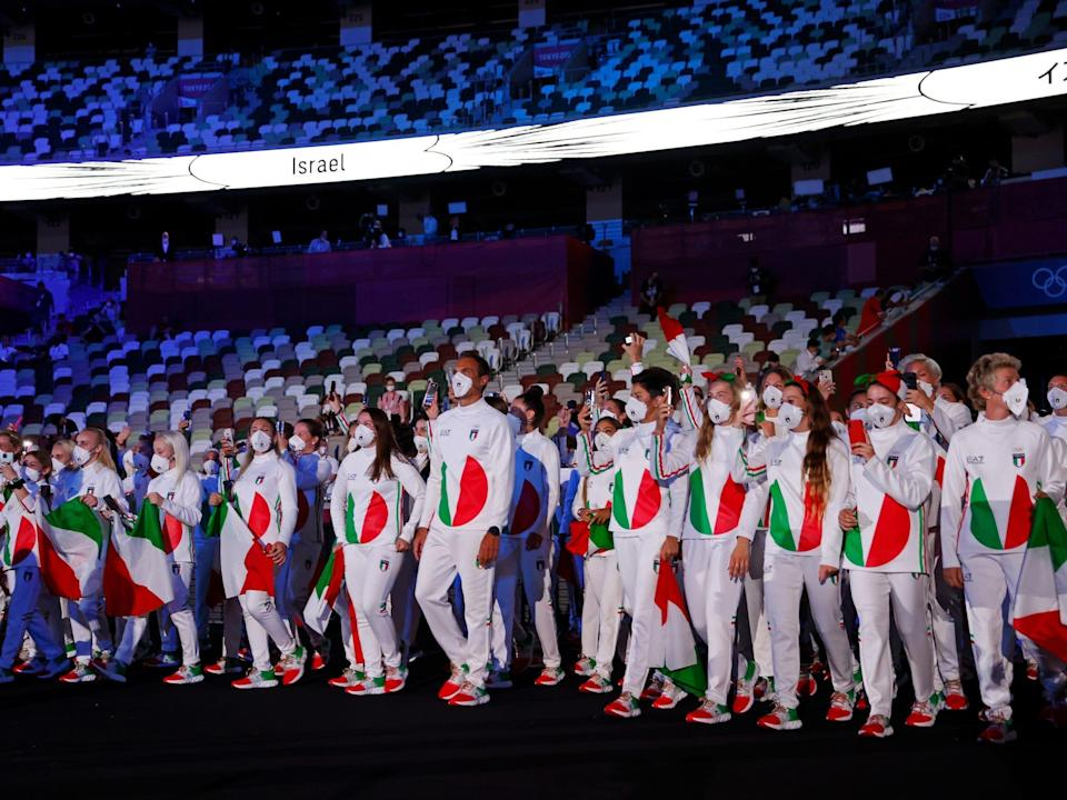 Team Italy enters Tokyo's Olympic Stadium for the opening ceremony.