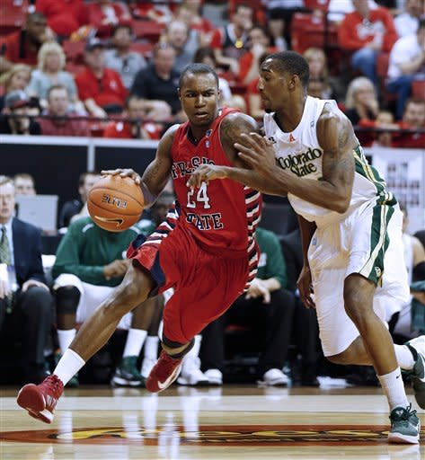 Fresno State's Kevin Foster drives past Colorado State's Greg Smith during the first half of a Mountain West Conference tournament NCAA college basketball game on Wednesday, March 13, 2013, in Las Vegas. (AP Photo/Isaac Brekken)