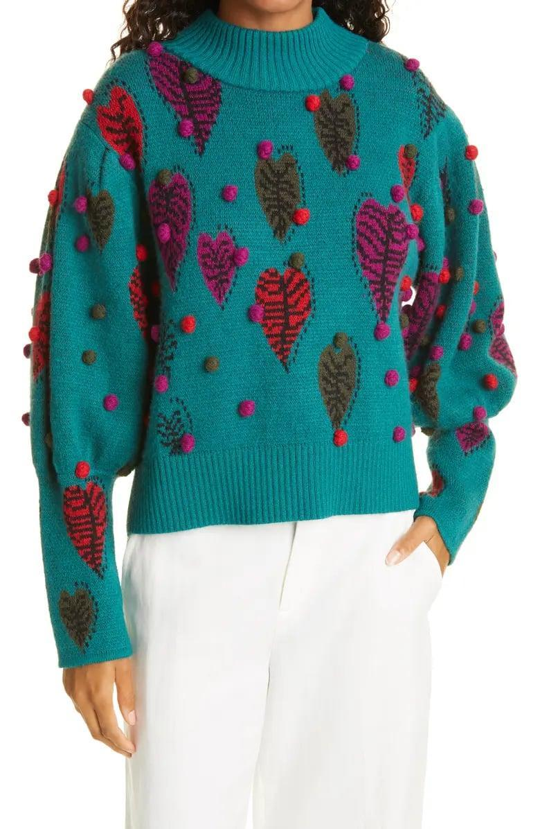 <p>There's nothing ordinary about this <span>Farm Rio Monstera Hearts Mock Neck Sweater</span> ($245) from the colorful leaves to all those mini pompoms. We'd especially love it with a super-light denim or even winter-white jeans.</p>