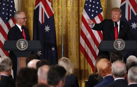 U.S. President Donald Trump (R) speaks as Australian Prime Minister Malcolm Turnbull looks on during a joint news conference at the White House in Washington, U.S., February 23, 2018. REUTERS/Jonathan Ernst
