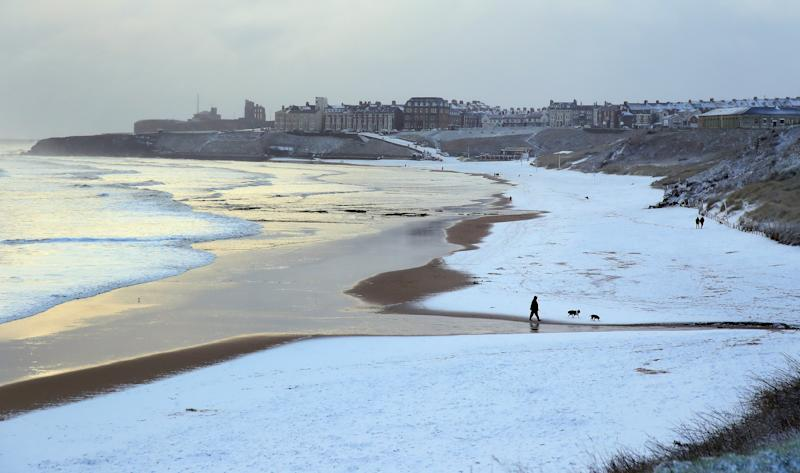 The sand turned white on Tynemouth beach on the North East coast yesterday following snow showers (PA)