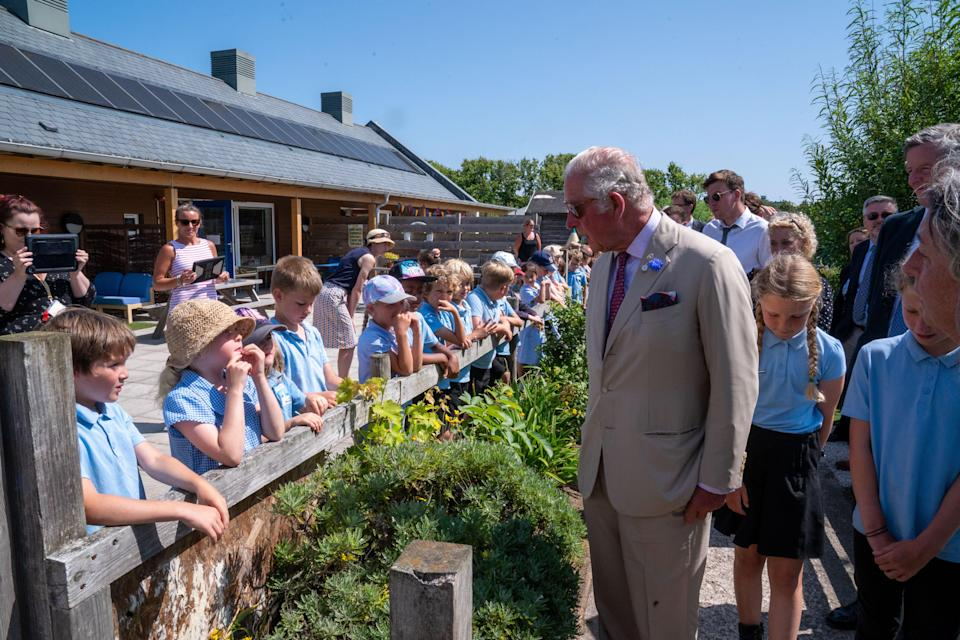 The Prince of Wales meets children at Five Islands Academy School (PA)