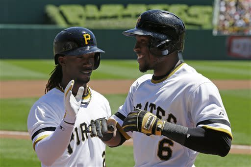 Pittsburgh Pirates' Starling Marte (6) is greeted by teammate Andrew McCutchen after hitting a leadoff solo home run off Washington Nationals starting pitcher Gio Gonzalez in the first inning of a baseball game in Pittsburgh, Sunday, May 5, 2013. (AP Photo/Gene J. Puskar)
