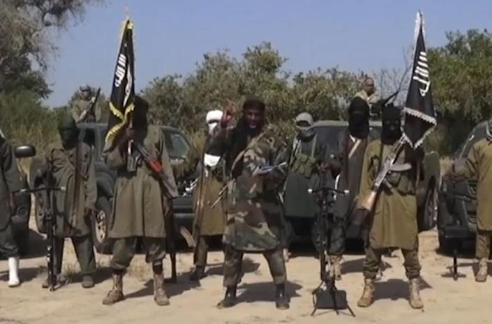 An image grab made on October 31, 2014 from a video obtained by AFP shows the leader of the Islamist extremist group Boko Haram Abubakar Shekau (C) delivering a speech (AFP Photo/)