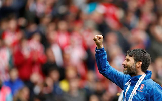 """Soccer Football - Checkatrade Trophy Final - Lincoln City vs Shrewsbury Town - Wembley Stadium, London, Britain - April 8, 2018 Lincoln City manager Danny Cowley celebrates Action Images/Andrew Boyers EDITORIAL USE ONLY. No use with unauthorized audio, video, data, fixture lists, club/league logos or """"live"""" services. Online in-match use limited to 75 images, no video emulation. No use in betting, games or single club/league/player publications. Please contact your account representative for further details."""