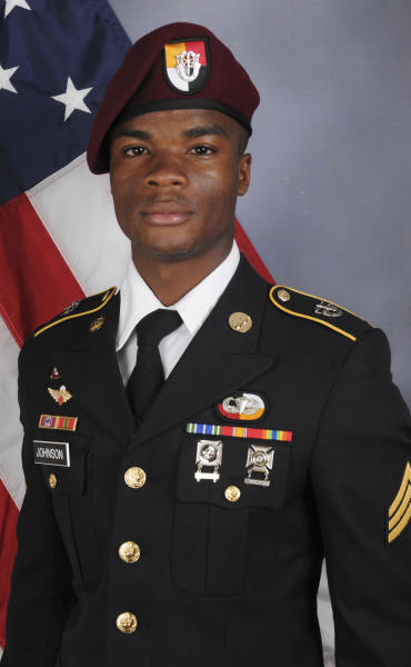 FILE - This file photo provided by the U.S. Army Special Operations Command shows Sgt. La David Johnson, who was killed in an Oct. 4 ambush in Niger. Johnson, who was killed in an ambush in Niger with three comrades and his body recovered days later, wasn't captured alive by the enemy or executed at close range, The Associated Press has learned, based on the conclusion of a military investigation. The report has determined that he was killed by enemy rifle and machine gun fire as he fled the attack by an offshoot of the Islamic State group. (U.S. Army Special Operations Command via AP, File)