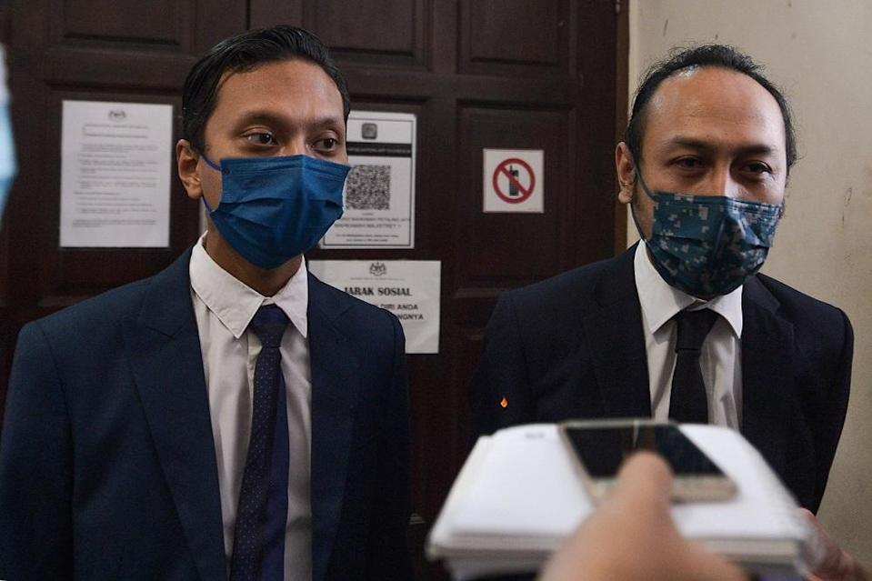 Lawyers Edly Mohammad Firdaus (left) and Mohd Haijan Omar (right) speak to reporters at the Petaling Jaya Magistrate Court July 21, 2021. — Picture by Miera Zulyana