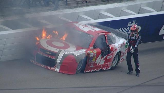 Larson quickly exits car after it catches fire