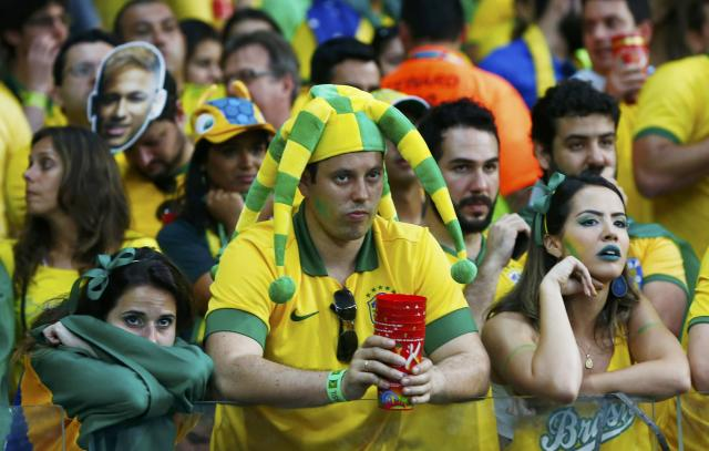 Fans of Brazil react during their 2014 World Cup semi-finals against Germany at the Mineirao stadium in Belo Horizonte July 8, 2014. REUTERS/Eddie Keogh (BRAZIL - Tags: SOCCER SPORT WORLD CUP)