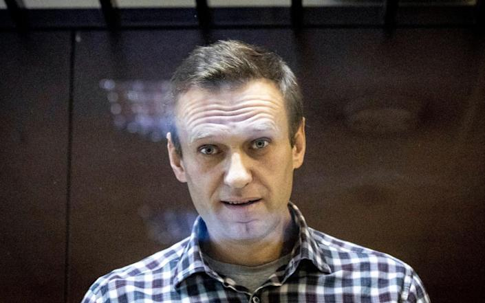 Alexei Navalny, who is serving a two-and-a-half-year jail sentence, denies being an extremist - AP