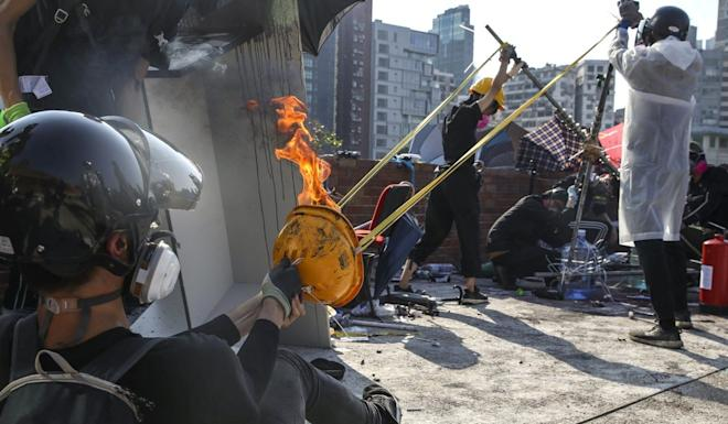 A catapult is used to fire petrol bombs at police. Photo: Winson Wong
