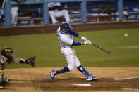 Los Angeles Dodgers' Mookie Betts hits his third home run of a baseball game during the fifth inning against the San Diego Padres, Thursday, Aug. 13, 2020, in Los Angeles. (AP Photo/Jae C. Hong)