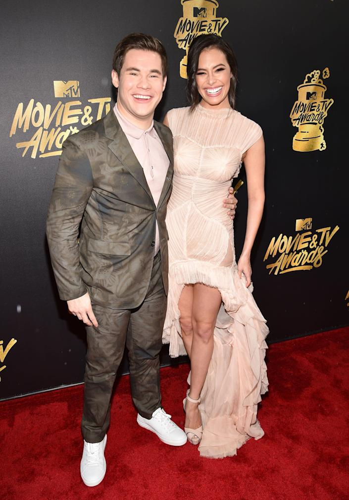 Host Adam DeVine (L) and actor Chloe Bridges attend the 2017 MTV Movie And TV Awards at The Shrine Auditorium on May 7, 2017 in Los Angeles, California.