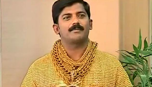 This YouTube screengrab shows 32-year-old money-lender Datta Phuge in his custom gold shirt.