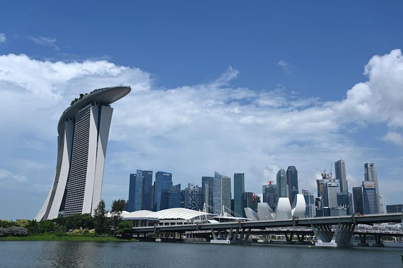 A general view shows the financial business district in Singapore on May 26, 2020. - Singapore's economy, a bellwether for global trade, could shrink by as much as 7.0 percent this year, the worst since independence, as the coronavirus pandemic throttles demand, the government said on May 26. (Photo by Roslan RAHMAN / AFP) (Photo by ROSLAN RAHMAN/AFP via Getty Images)