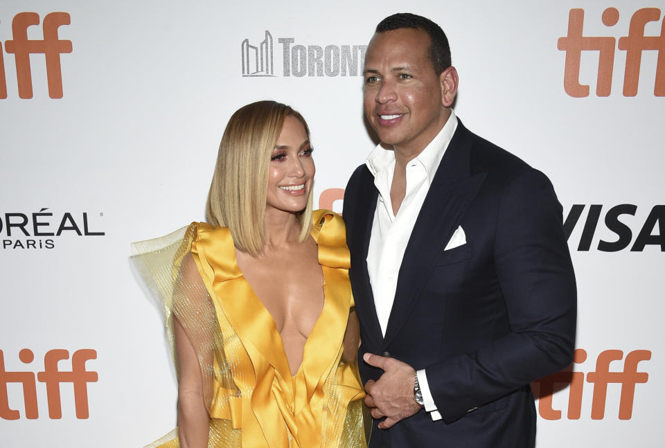 """Jennifer Lopez, left, and Alex Rodriguez attend the premiere for """"Hustlers"""" on day three of the Toronto International Film Festival at Roy Thomson Hall on Saturday, Sept. 7, 2019, in Toronto. (Photo by Evan Agostini/Invision/AP)"""