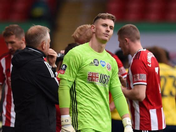 Sheffield United's Dean Henderson shows his frustration after being beaten from the spot (POOL/AFP via Getty Images)