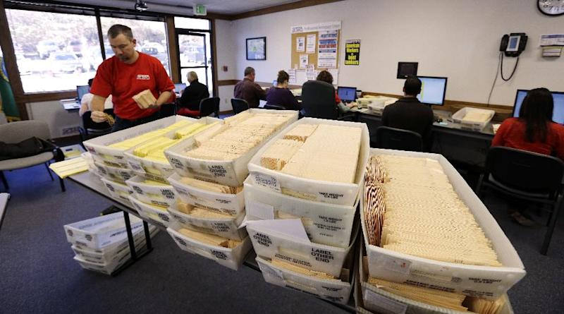 Workers begin to validate returned ballots at the headquarters of the union for Boeing Co.'s engineers and technical workers, Tuesday, Feb. 19, 2013, in Tukwila, Wash. Members of the Society of Professional Engineering Employees in Aerospace (SPEEA) are voting on a contract offer from the company and whether to authorize a strike. The union represents 23,000 employees, mostly in the Puget Sound region. Negotiations began in April and union members rejected one offer in October. The previous contract expired in November. (AP Photo/Elaine Thompson)