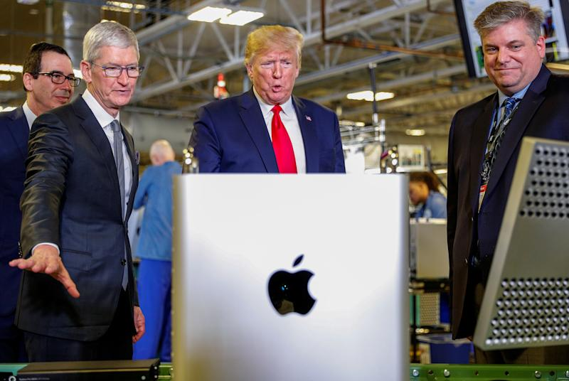 Apple CEO Tim Cook escorts U.S. President Donald Trump as he tours Apple's Mac Pro manufacturing plant with in Austin, Texas, U.S., November 20, 2019. REUTERS/Tom Brenner