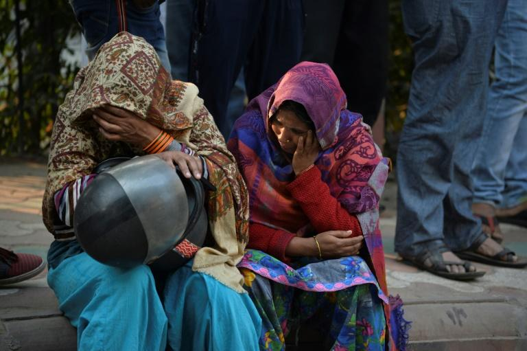 Tearful relatives spoke of receiving desperate calls from factory workers pleading to be freed from the inferno (AFP Photo/Sajjad  HUSSAIN                     )