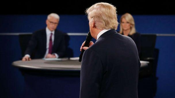 PHOTO: Moderators Anderson Cooper and Martha Raddatz listen as Republican presidential nominee Donald Trump speaks during the second debate at Washington University in St. Louis, Missouri on Oct. 9, 2016. (Pool via AFP/Getty Images)